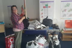 Sharon, collecting for refugees