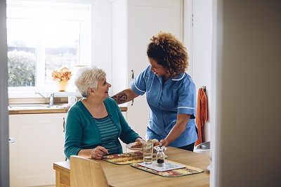 domiciliary care worker with alzheimers sufferer